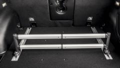 Uitschuifbare stang voor organizer kofferbak